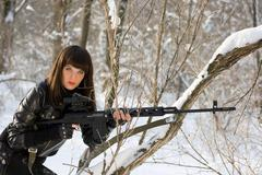 young woman with a sniper rifle - stock photo
