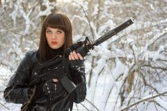 Portrait of young lady with a rifle Stock Photos