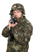 Soldier aiming a rifle. Closeup - stock photo
