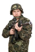 Armed soldier pointing m16. Upperhalf Stock Photos
