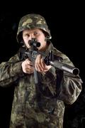 Alerted soldier keeping a gun Stock Photos