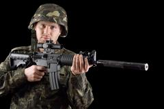 Alerted soldier holding m16 - stock photo