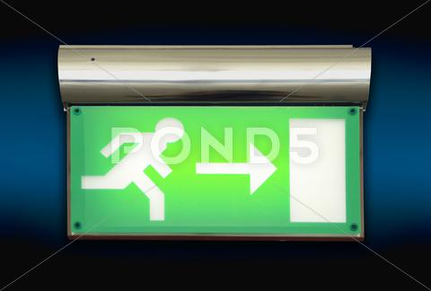 Stock photo of emergency exit sign glowing green