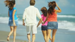 Carefree Parents Teenage Daughters Beach Lifestyle - stock footage
