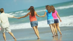Happy Caucasian Family Walking Outdoors Wet Sand on Beach Stock Footage