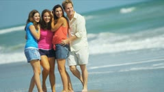 Happy Caucasian Family Enjoying Time Together on Beach Stock Footage