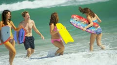 Teenage Girls Parents Beach Body Board Stock Footage