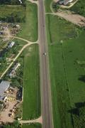 country road and green field aerial view - stock illustration
