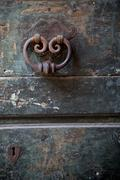 old door-knocker with keyhole - stock photo