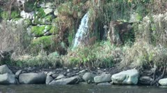 Water falling from a rocky wall Stock Footage