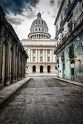 street with crumbling buildings leading to the capitol in old ha - stock photo