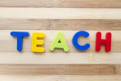 "letter magnets ""teach"" - stock photo"