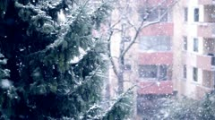 falling snow in city - stock footage