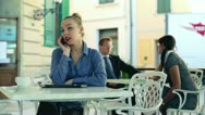 Stock Video Footage of Businesswoman with cellphone working in cafe, outdoors