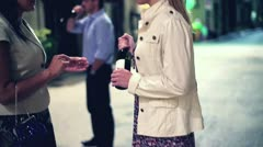 Happy people with bottle of vine standing on the street in the evening Stock Footage