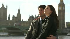 Man and woman standing together in London Stock Footage