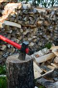 axe and woodpile. - stock photo