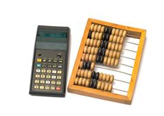 calculator and wooden abacus. - stock photo