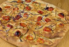 Tomatoe and onion bread Stock Photos