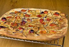 foccacia with tomatoes and onions - stock photo