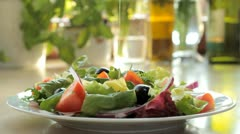 Pour olive oil over the salad - slow motion - stock footage
