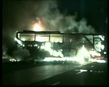 Bus on fire at night riots in Indonesia Stock Footage