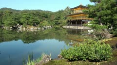 Beautiful 'Golden Pavillion' and traditional Japanese garden in Kyoto Stock Footage