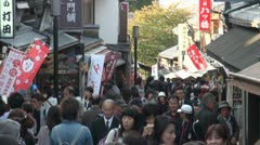 Japan tourist street temple complex crowd busy tourism Japanese Kyoto Stock Footage