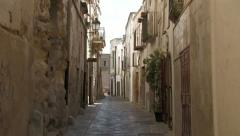 Narrow street in Italian village - stock footage