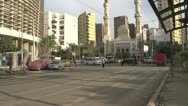 Stock Video Footage of street traffic in Alexandria, traffic past mosque, medium shot