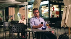 Young man scolding a woman for be late in the restaurant, evening Stock Footage