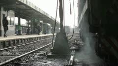 Railway station. Tracks, trains and people on the platform. Stock Footage