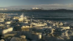 Ice Chunks on Lands End Beach Waves and Kenai Mountains in Alaska Stock Footage