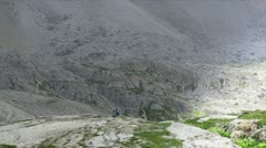 Couple seated in front of  the giant mountains dolomites Stock Footage