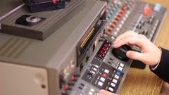 Editor working on Betacam Sp recorder Stock Footage