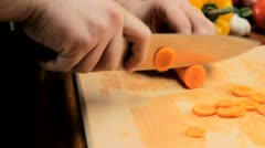 Cutting carrots - tracking shot - stock footage