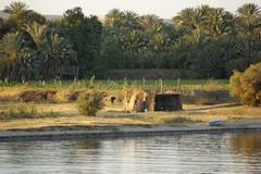 river nile scenery between aswan and luxor - stock photo