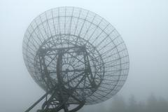 Radiotelescope in the fog Stock Photos
