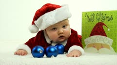 Baby in Santa Claus suit Stock Footage