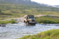 Russian truck Ural crossing a small river Stock Photos