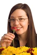 secretary, assistant or student woman smelling flowers - stock photo