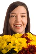 smiling secretary, assistant or student woman smelling flowers - stock photo