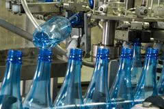 Water bottle production machine Stock Photos
