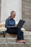 African american college student with laptop Stock Photos