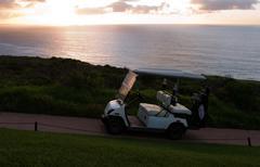 golf cart at seaside holiday resort - stock photo