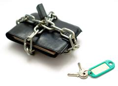 Wallet locked up in chains with Keys Stock Photos