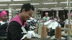 Textile Garment Factory Workers: MCU standing smiling male garment worker Stock Footage