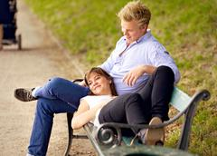 Happy couple bonding in a park Stock Photos