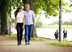 Couple in love strolling in a park Stock Photos