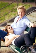 sweet guy with girlfriend resting on his lap - stock photo
